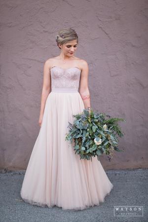 bride in blush wedding dress with bridal bouquet