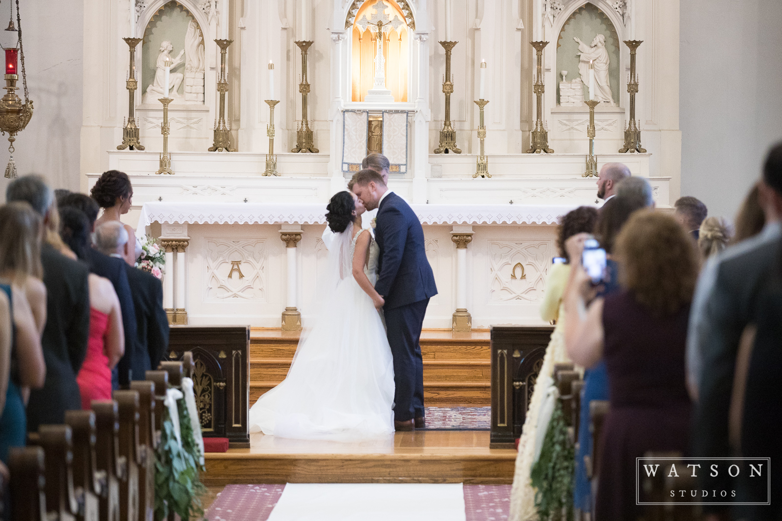 Bride and Groom kiss at Church of the Assumption Nashville